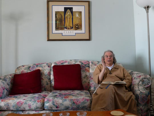 Sister Judith enjoys her time in retreat with a book
