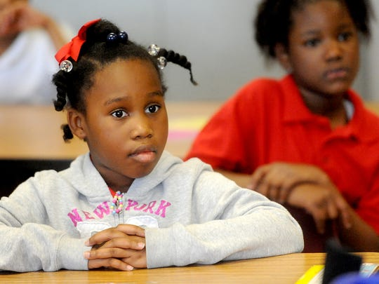 Second-grader Briana Young listens during a Girls of Essence meeting at Caddo Heights Elementary School in Shreveport. The group meets once a month and promotes self-esteem and community involvement.