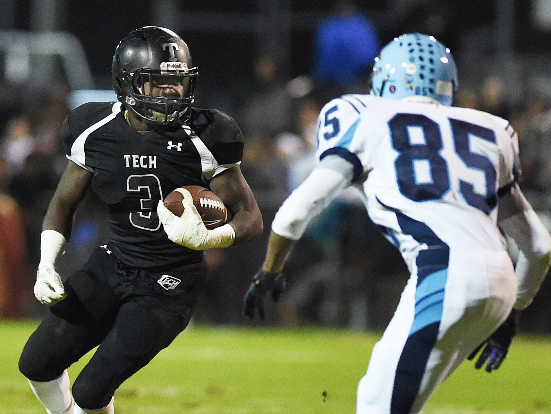 Sussex Techs Patrick Griffin moves the ball as Cape's Deandre Shepard defends. Griffin had four rushing touchdowns in Tech's win over Cape in Georgetown on Friday.