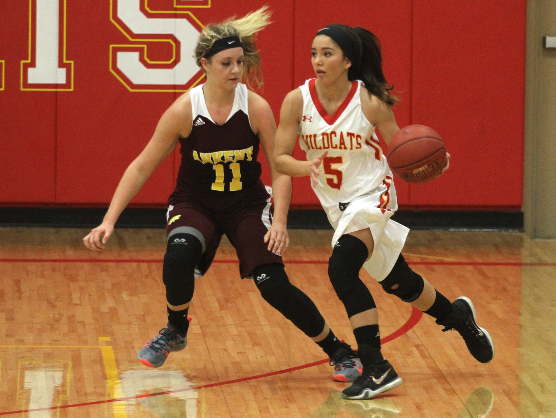 Ankeny junior Codee Myers defends against Carlisle sophomore Amber Kettering. Class 4A 15th-ranked Carlisle beat Ankeny 57-44 in the Wildcats' home opener on Nov. 24.