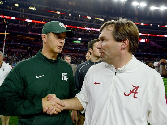 Brad Salem, shown shaking hands with Alabama's Kirby Smart after the 2015 College Football Playoff semifinal, got a pay raise of more than $115,000 to become Michigan State's new offensive coordinator.