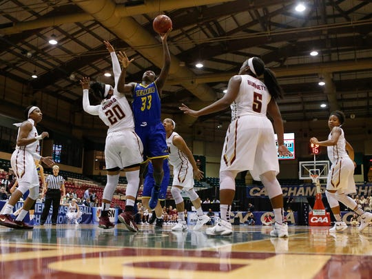 Delaware forward Nicole Enabosi shoots over Elon's Nikki McDonald in the second half of the Hens' 57-50 win in a CAA tournament semifinal at the Show Place Arena in Upper Marlboro, Md. Thursday.