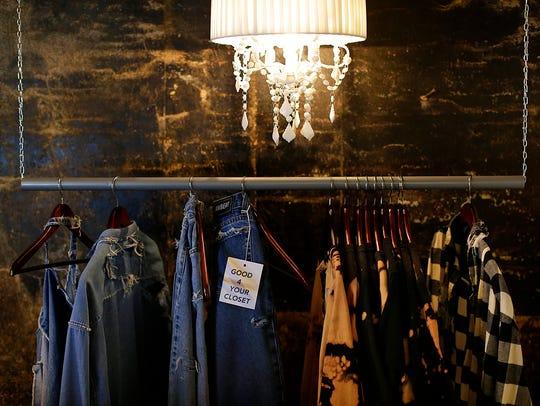 Clothing hangs in fashion designer Tyler Lambert's