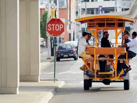 A HandleBar pub bike takes a group through    downtown Detroit.