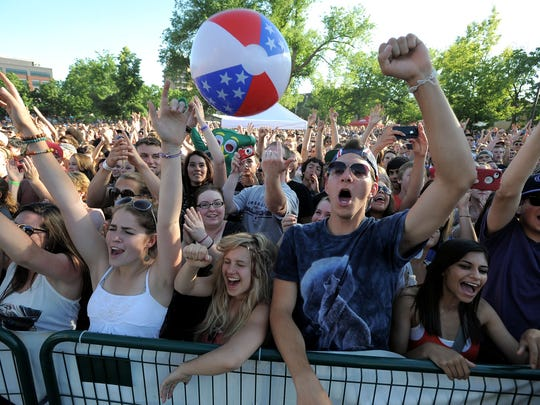 Awolnation fans cheer as the American electronic rock band takes the stage during their headlining performance at the 2013 Taste of Fort Collins.