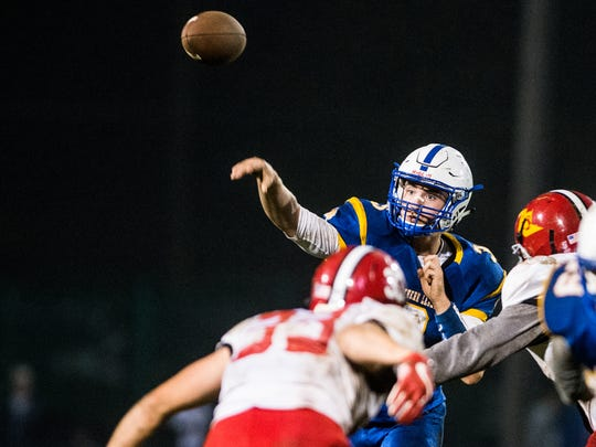 Northern Lebanon's Michigan Daub throws down the field for one of his three touchdown passes in the Vikings' 41-13 win over Annville-Cleona.