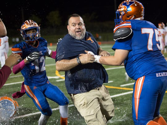 York's head coach, Russ Stoner, tries to avoid a Gatorade bucket. York defeated Central York 26-19 to win the 2017 Division I title.