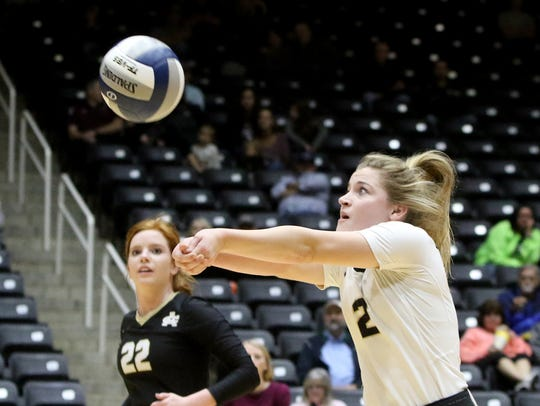 Archer City's Sam Clements receives the serve from
