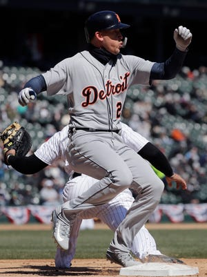 Tigers left fielder JaCoby Jones is out at first base against the White Sox during the third inning on Saturday, April 7, 2018, in Chicago.