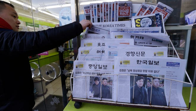 Newspapers reporting North Korean leader Kim Jong Un, bottom right, proposed a summit with South Korean President Park Geun-hye, are sold at a store in Seoul, South Korea, Friday, Jan. 2, 2015. Kim said in a New Year's speech Thursday that he is open to more talks or even a summit with his South Korean counterpart, a statement welcomed by Seoul, which in turn urged the North to take concrete steps toward normalization of relations.