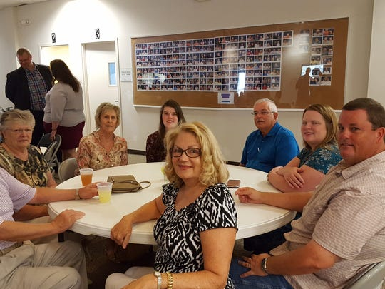 Pictured are one of the 18 tables of Capri Christian Church members and their guests who attended a surprise appreciation celebration honoring Pastor Curt Ayers and his wife, Dreama.
