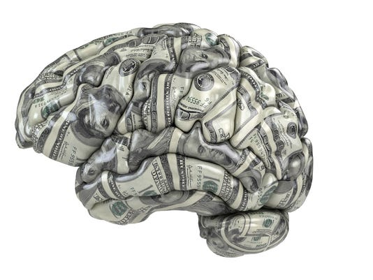 Human brain with dollars texture .