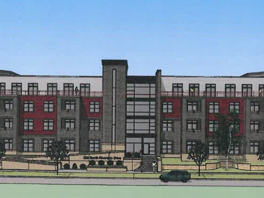 An architect's rendering of a 96-unit apartment building planned for South Riverside Drive, where Hartwig Motors was once located.