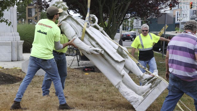 Workers remove a Christopher Columbus statue from Christopher Columbus Blvd. and Arctic Ave in Atlantic City, NJ Wednesday July 1, 2020. The Christopher Columbus monument, in the resort since 1958, was taken down from its location at the base of the Atlantic City Expressway Wednesday morning.