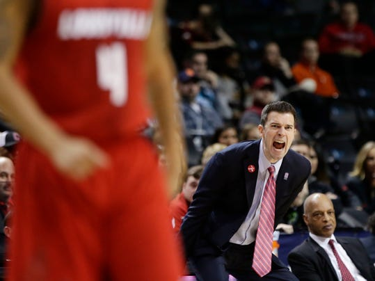 Louisville head coach David Padgett calls out to his team during the second half of an NCAA college basketball game against Florida State in the second round of the Atlantic Coast Conference tournament Wednesday, March 7, 2018, in New York. Louisville won 82-74. (AP Photo/Frank Franklin II)