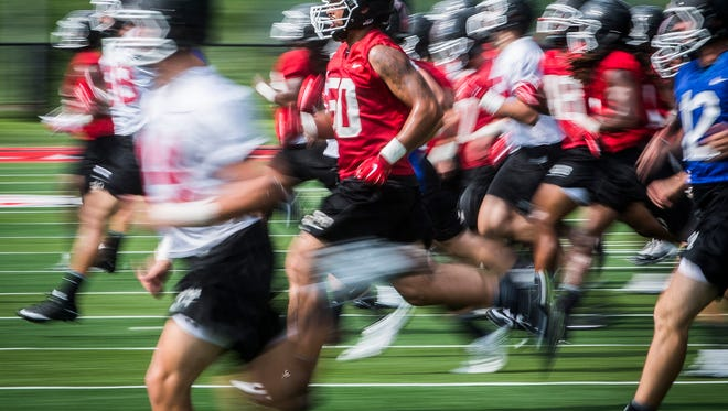 Ball State football players run sprints at the end of practice at Scheumann Stadium Thursday afternoon.