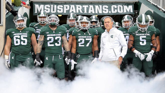 Michigan State Spartans head coach Mark Dantonio prepares to enter the stadium prior to a game against the Penn State Nittany Lions at Spartan Stadium.