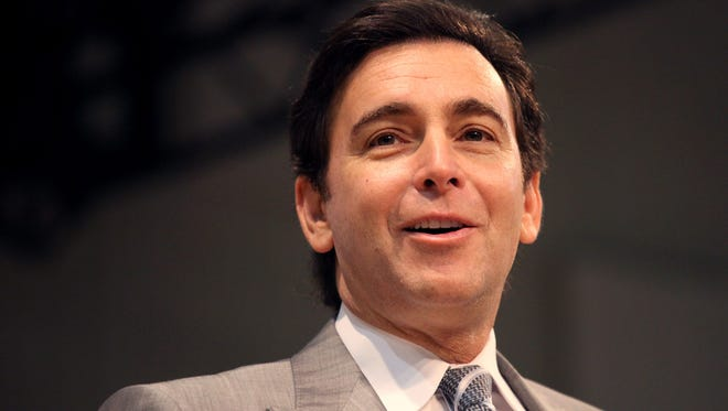Ford Motor President, CEO Mark Fields delivers the keynote speech during the 2014 Detroit Free Press Top Workplaces breakfast at the Shriners Silver Garden Event Center in Southfield on Wednesday, Nov. 12, 2014.
