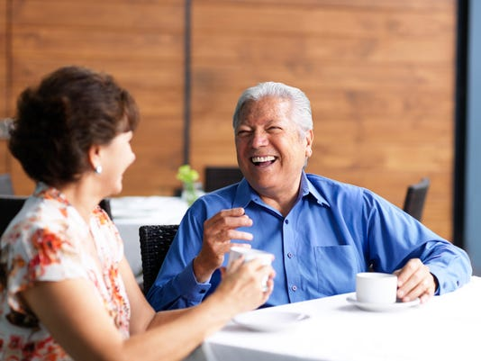 Senior couple talking in a restaurant