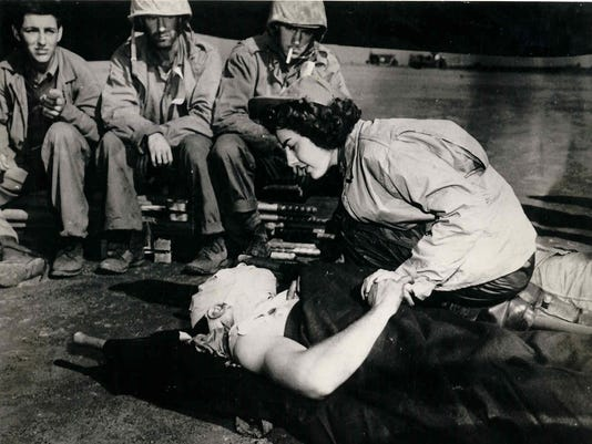 Flight_nurse_Jane_Kendeigh_caring_for_wounded_soldier_on_Iwo_Jima--1945.jpg