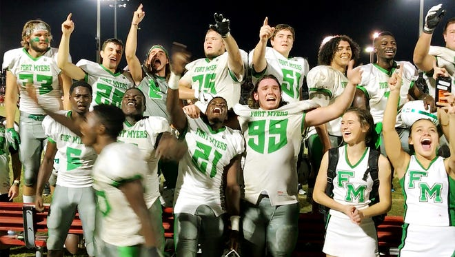 Fort Myers High School football players celebrate beating North Fort Myers on Friday in the regional semifinal game at North Fort Myers. Fort Myers beat North 7-6 and will play Naples in the upcoming regional final.