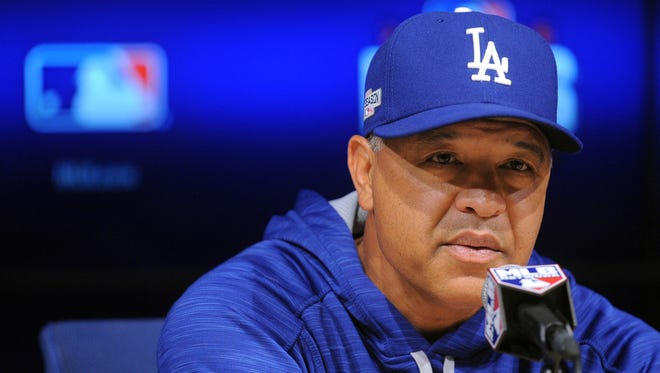 Los Angeles Dodgers manager Dave Roberts speaks to media before game three of the NLCS against the Cubs.