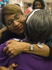 Former municipal Judge Desiree Charbonnet hugs her