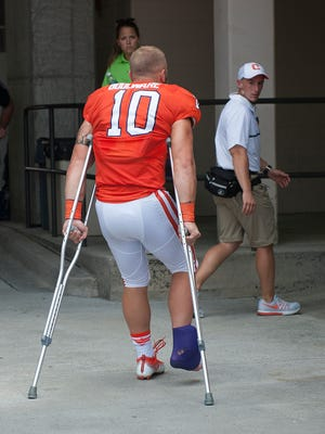 Clemson linebacker Ben Boulware (10) leaves the game on crutches during the 4th quarter Saturday, September 10, 2016 at Clemson's Memorial Stadium.