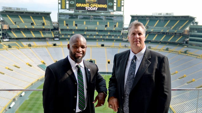 Ahman Green, left, and Ken Ruettgers are shown at Lambeau Field before the Green Bay Packers Hall of Fame induction banquet Saturday.
