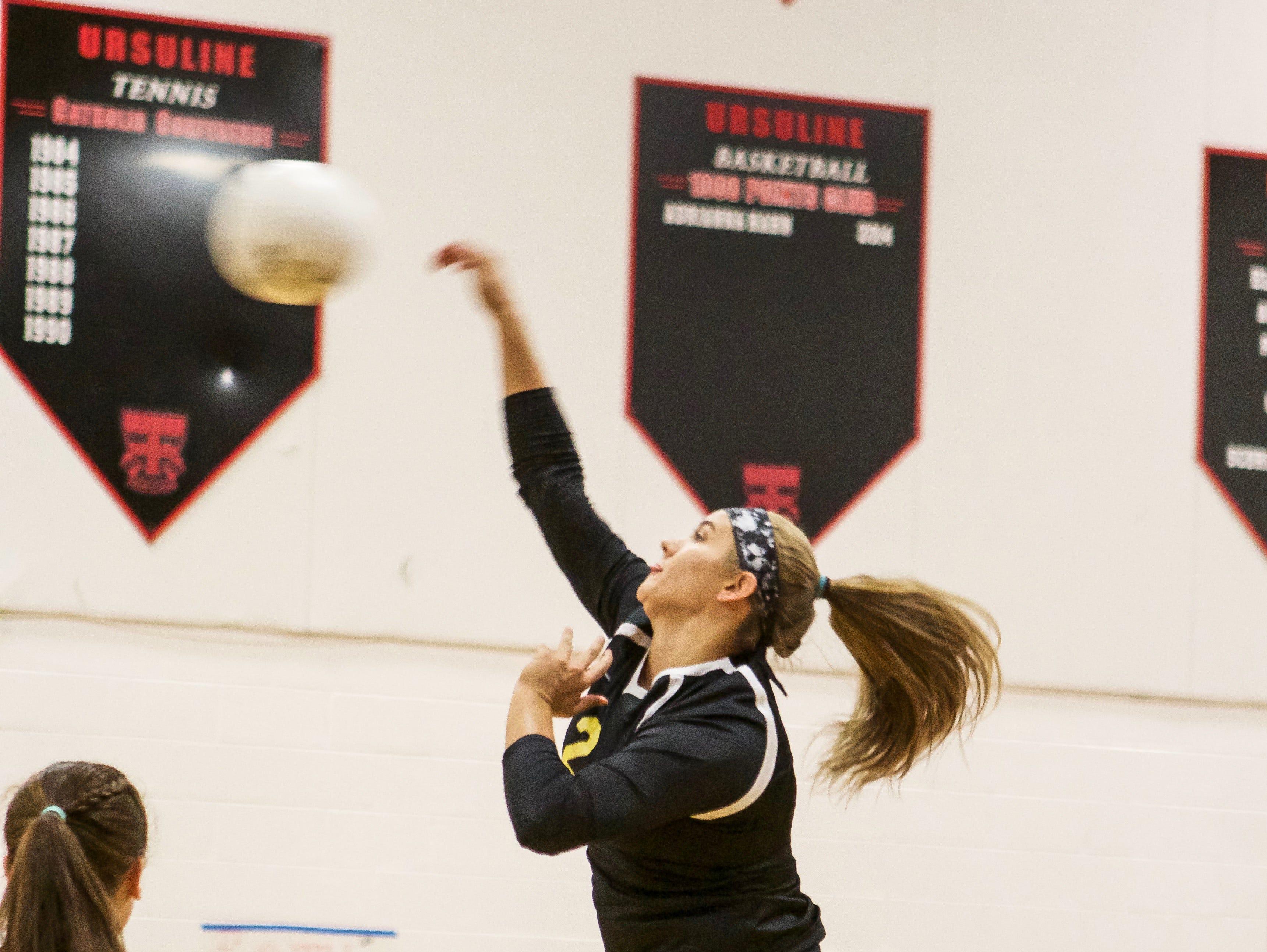 Padua's Emily Jarome strikes the ball over the net against Ursuline.