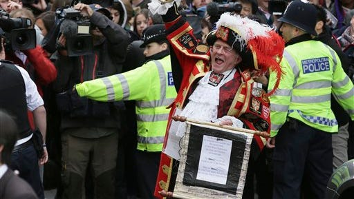 Tony Appleton, a town crier, announces to the assembled media the birth of the royal baby, outside the Lindo Wing, St. Mary's Hospital, London, Saturday, May 2, 2015. Kate, the Duchess of Cambridge, has given birth to a baby girl, royal officials said Saturday.  (AP Photo/Tim Ireland)