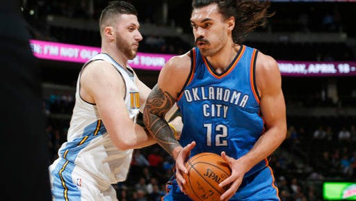 Oklahoma City Thunder center Steven Adams, right, drives as Denver Nuggets center Jusuf Nurkic defends during the first half of an NBA basketball game Tuesday, April 5, 2016, in Denver. (AP Photo/David Zalubowski)