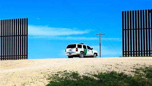 A Border Patrol vehicle is  seen near the border wall in Mission, Texas.