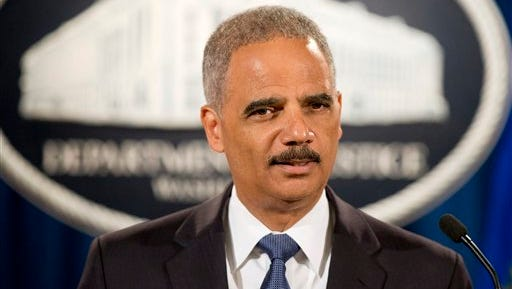In this Sept. 4 file photo, Attorney General Eric Holder speaks during a news conference at the Justice Department in Washington. A White House official says Attorney General Eric Holder is resigning.