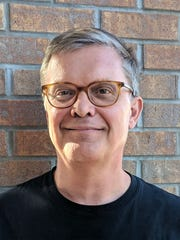 Ted Rueter, a professor of political science with the University of Maryland, poses on Sept. 28, 2017 iin Middleton, Wis. He founded the nonprofit Noise Free America.