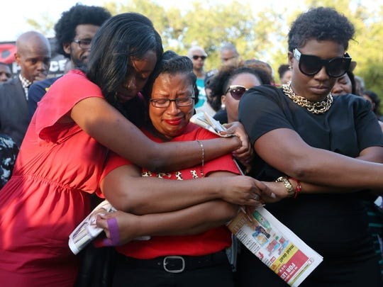 Lanitra Dean hugs Carlesha Harrison, a friend of Sandra Bland, during a vigil for Bland at Prairie View A&M University, Sunday, July 19, 2015, in Prairie View, Texas.