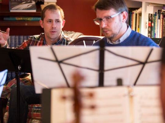 Composer Daniel Gilliam reviews notes with Clarinetist Matthew Nelson during rehearsal for the final concert of Kentucky Center Chamber Players in 2015