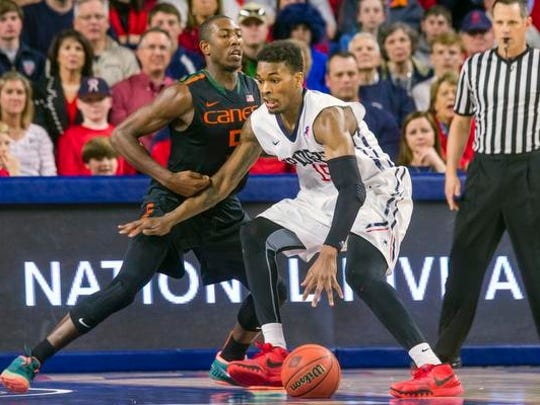 Miami guard Davon Reed, left, defends against Richmond forward Terry Allen, right, during the second half of an NCAA basketball game during the NIT tournament in Richmond, Va., on Tuesday, March 24, 2015.  Miami won 63-61.