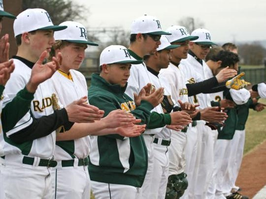 The Piscataway Tech baseball team applauds during a