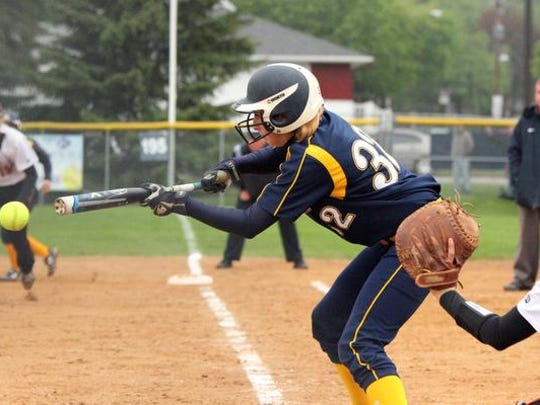 Vikings shortstop Sarah Kennedy lays down a bunt in Sunday's game.