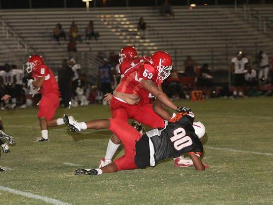 David Griffin pancakes a defensive lineman as a member