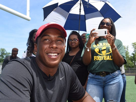 Khalid Kareem announces his decision to play for Alabama on Wednesday at Farmington Hills Harrison.