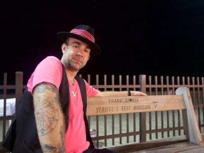 Frank DeVille, a street magician, poses on his bench.