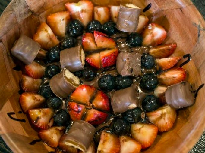 A mix of strawberries, blueberries, Nutella, and Twix