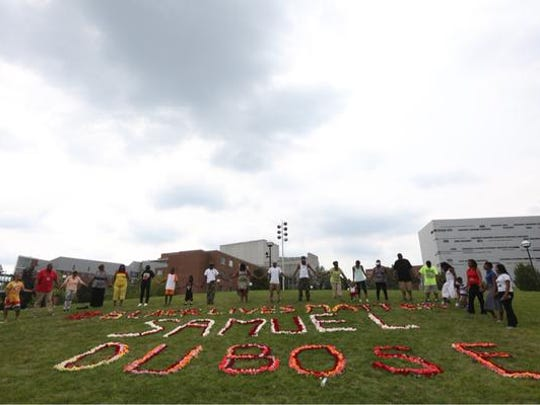Memorial of roses placed on UC campus by family and friend of Samuel Dubose.