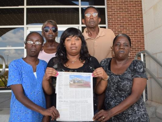 ANI Culbert FamilyThe family of Vivian Chaney who was murdered in 1985, read an article in The Town Talk that Vivian's murderer is among those involved in a lawsuit complaining of the inhumane conditions on death row at Angola. Tomika Chaney (left, blue blouse), is the daughter of Vivian Chaney and was in the house when her mother and sister plus six others were murdered. Shirley Culbert-Johnson (center, bottom), sister of Vivian Chaney, found the victims in the house. Kela Culbert-Barraka (far right, bottom), Barabara Culbert (back, far left) and Albert Culbert, Jr. are siblings of Vivian Chaney.-Melinda Martinez/The Town Talk