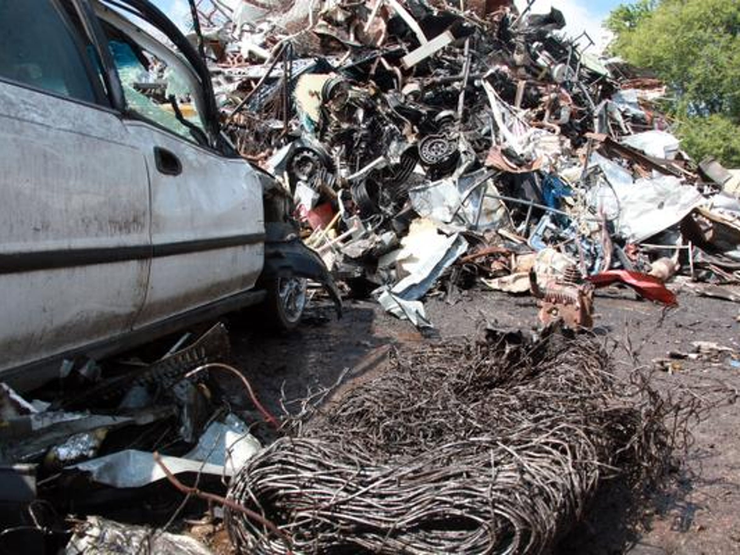 A junker car adds to the scrap heap at Recycle Management in East Waynesboro on Saturday, September 12. The Harrisonburg-based company grew an operation here a few years ago that's doing a thriving business providing cash for anything from old stoves to sofa springs.