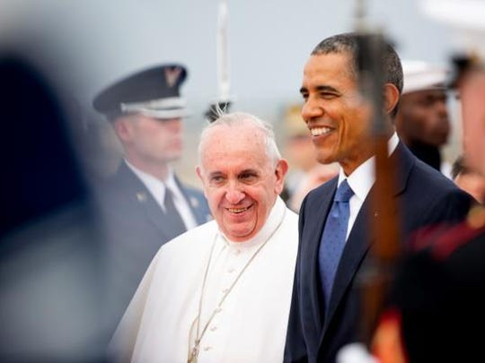 President Barack Obama walks across the tarmac with Pope Francis upon his arrival at Andrews Air Force Base, Md., Tuesday, Sept. 22, 2015. (AP Photo/Andrew Harnik)