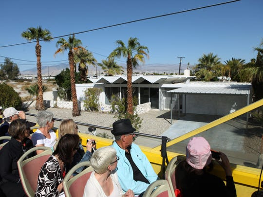 Architecture enthusiasts take part in the  bus tour of mid-century modern architecture during Modernism Week.