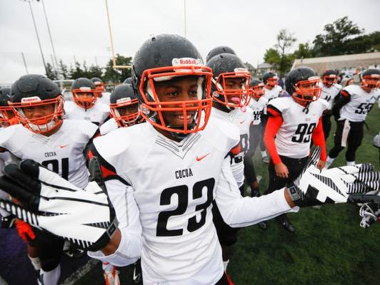 Cocoa's Jeremy Lawson (23) rallies the team before their game against St. Edward at St. Edward High School in Lakewood, Ohio, Oct. 3, 2015. St. Edward beat Cocoa 24-14.